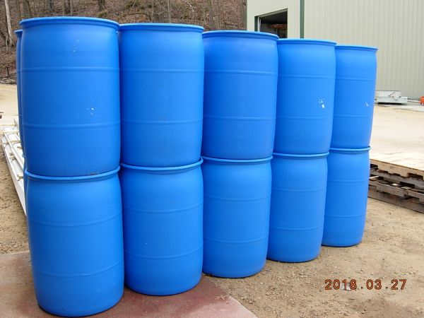 Lots of Blue Plastic Barrels